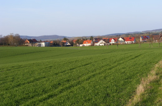 Small German village behind green fields