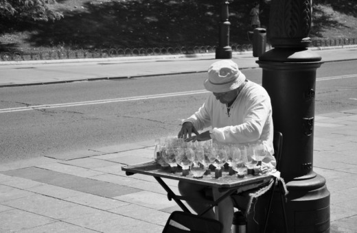 Man playing music on whineglasses