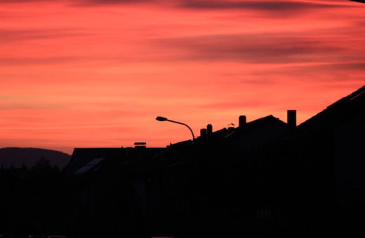 Red-orange sundown in the village