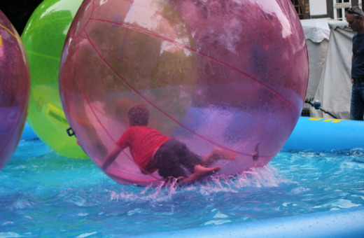 Small boy inside giant beach ball