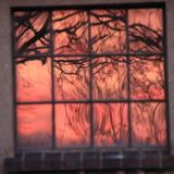 Sundown reflects in window