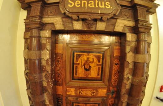 Heavy-wooden-door-inside-Pragues-old-townhall