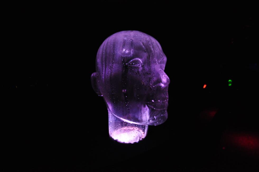 Purple illuminated glass head