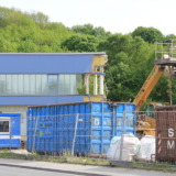Containers and a half house at deconstruction site