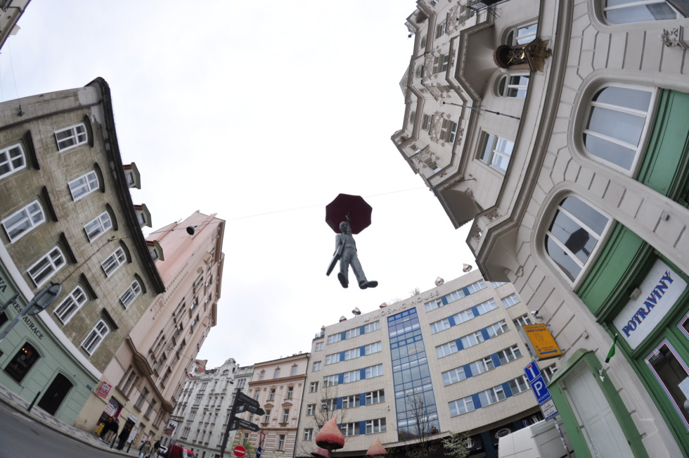 Flying statue of a man with umbrella in Prague