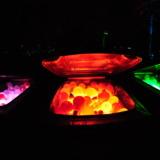 Glowing balls in trashcans