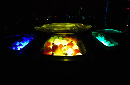 Three-colored glowing lightbulbs in trash cans