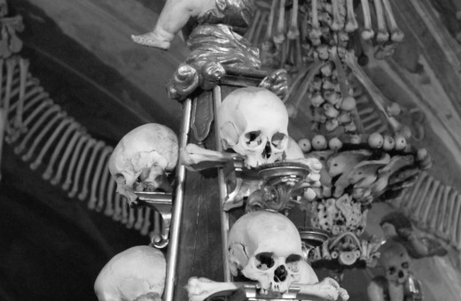 Angel sitting on skulls
