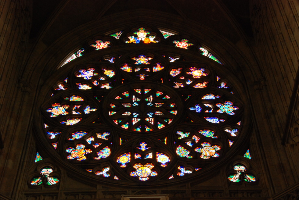 Colorful church window in St. Vitus cathedral, Prague