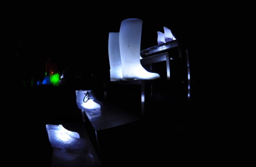 Illuminated shoe pairs on a stair