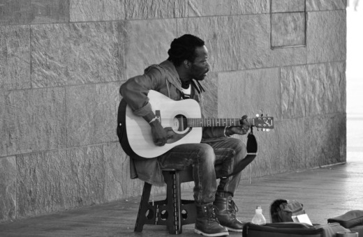 Black guy playing guitar in Cologne