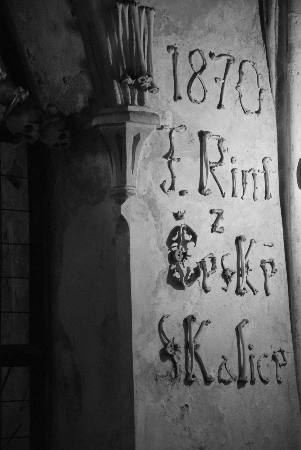 Lettering made of bones in Kutná Hora's ossuary