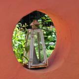 Lantern in wall arch