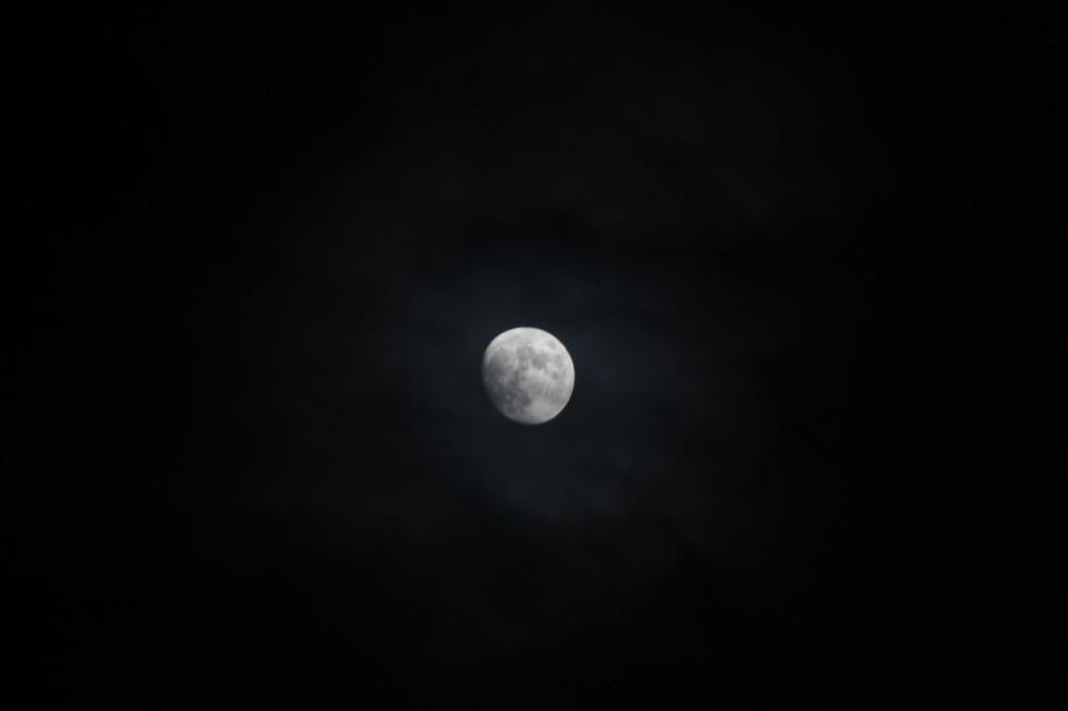 Full moon in dark sky