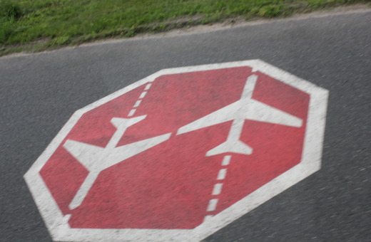 Beware of airplanes sign on the street
