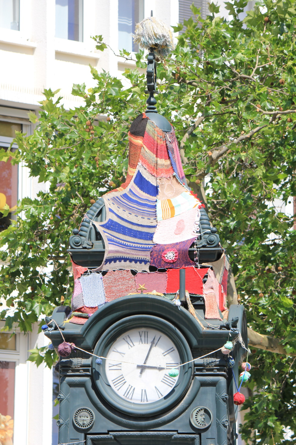 Guerilla knitting on old clock in Hannover