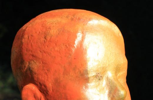 Sprayed and defaced bronze sculpture