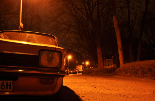 Orange Opel Kadett at night