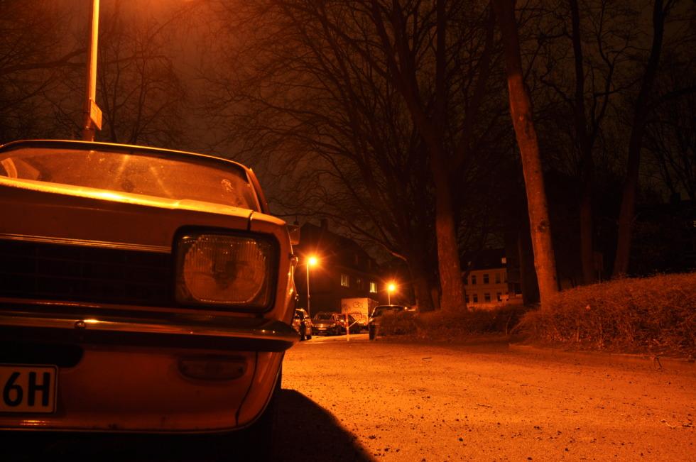 Orange Opel Kadett at night