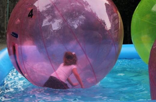 Girl in giant waterball