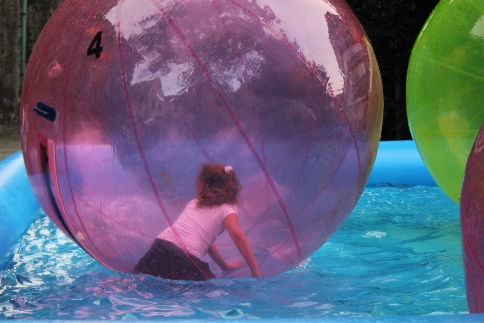Girl in giant waterball