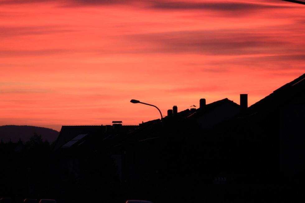 Red-orange sundown in the village