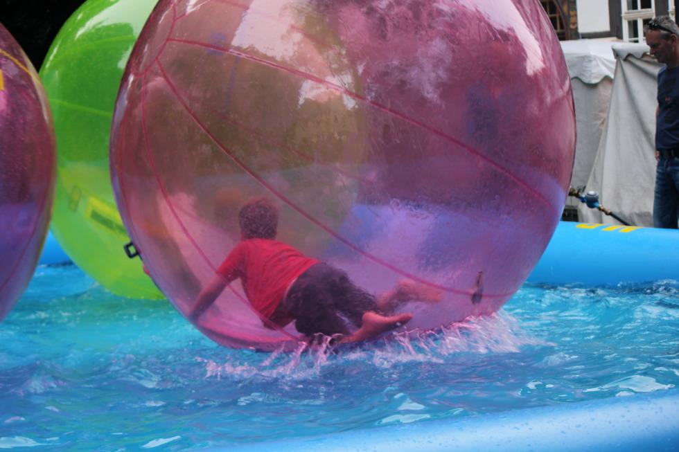 Small boy inside giant beach ball