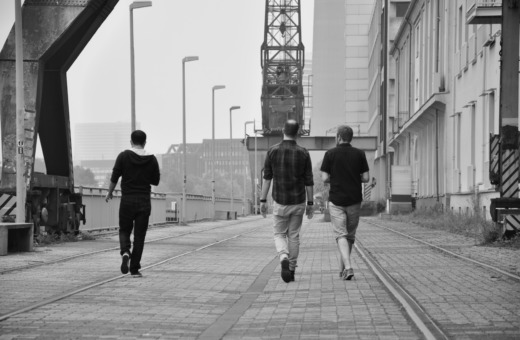 Three men walking at Medienhafen Düsseldorf
