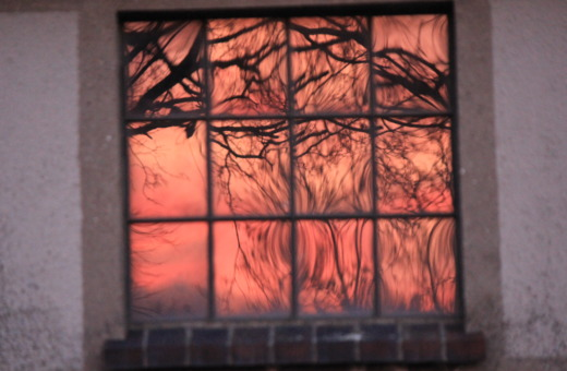 Sundown reflects in window