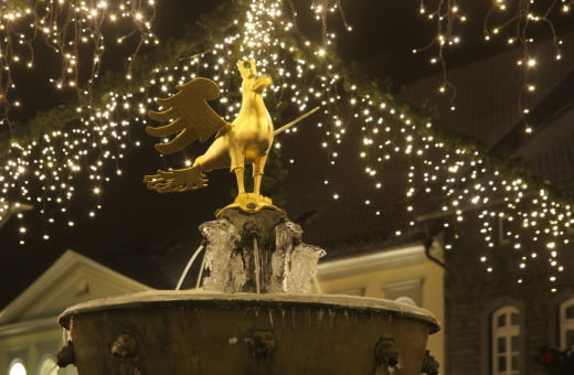 Golden eagle statue on market fountain in Goslar