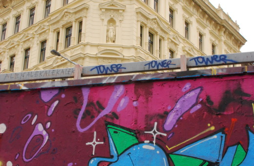 Graffiti in front of classical building in Prague