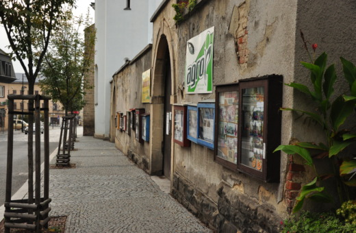 Lots of showcases on an old wall in Turnov