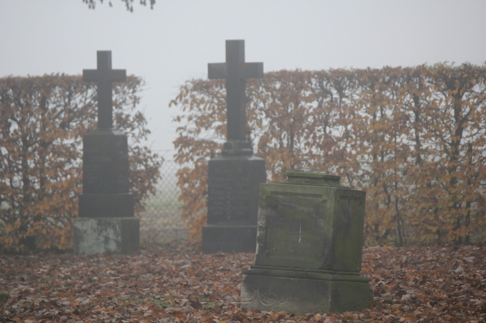 Tombstones in fog