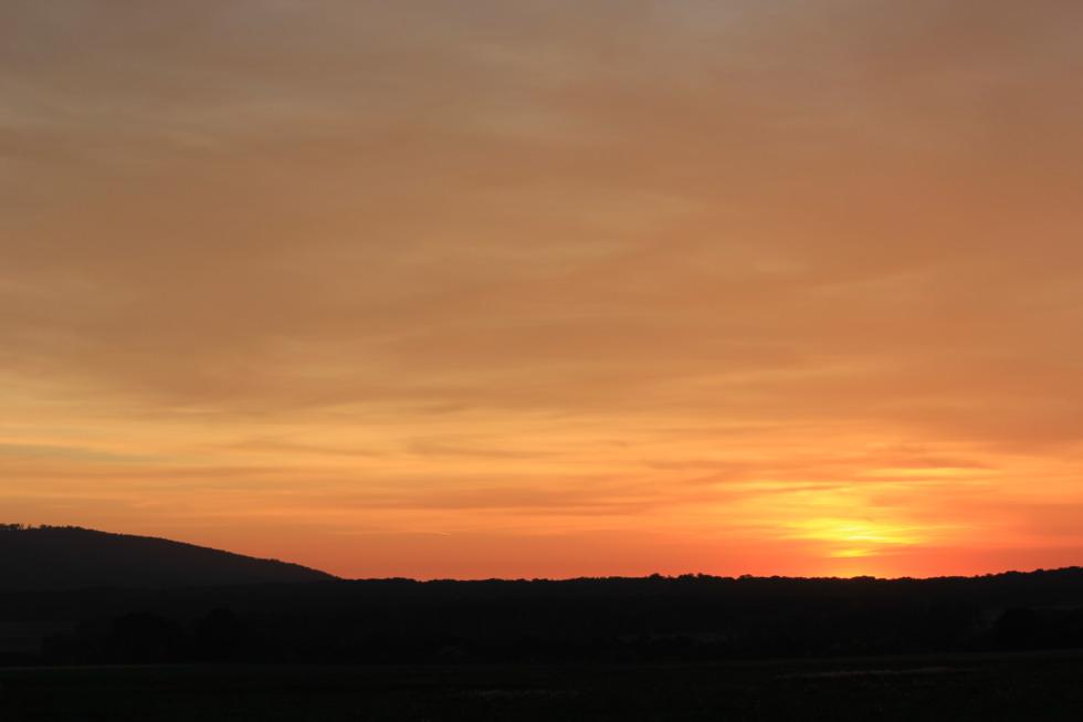 Orange sundown behind Bredelem