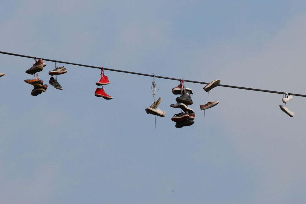Shoes hanging on a rope over Prague