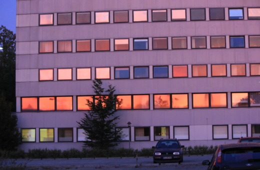 Orange sun reflecting in windows