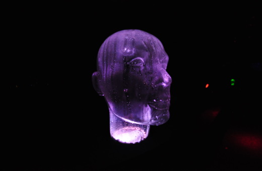 Purple illuminated glass head