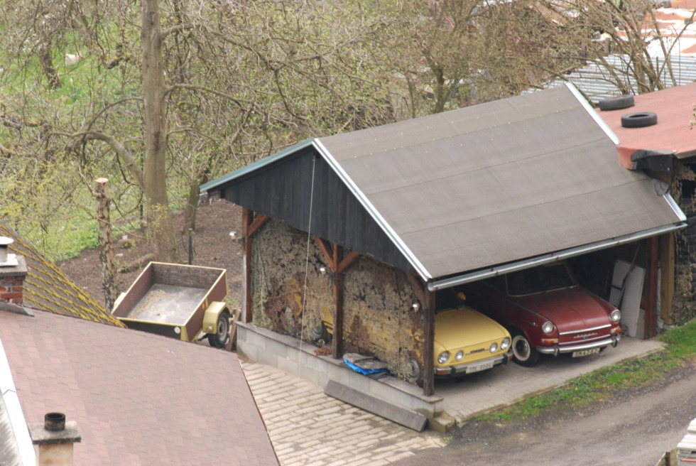 Two old czeach cars in carport