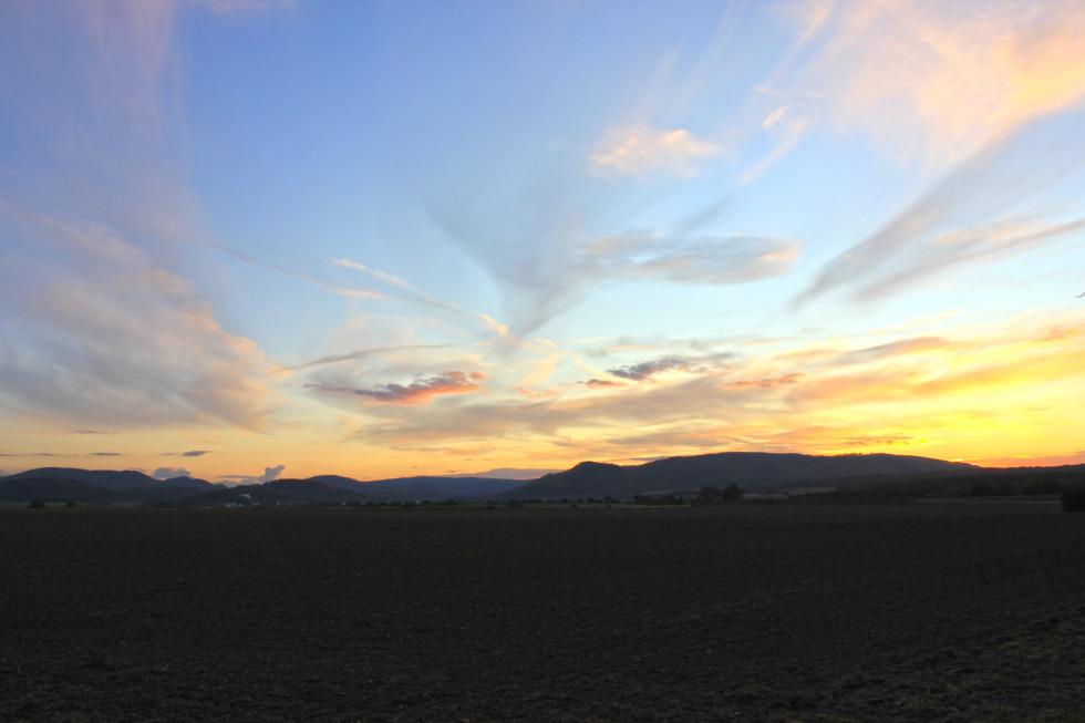 Blue sky, partly tinted by sundown