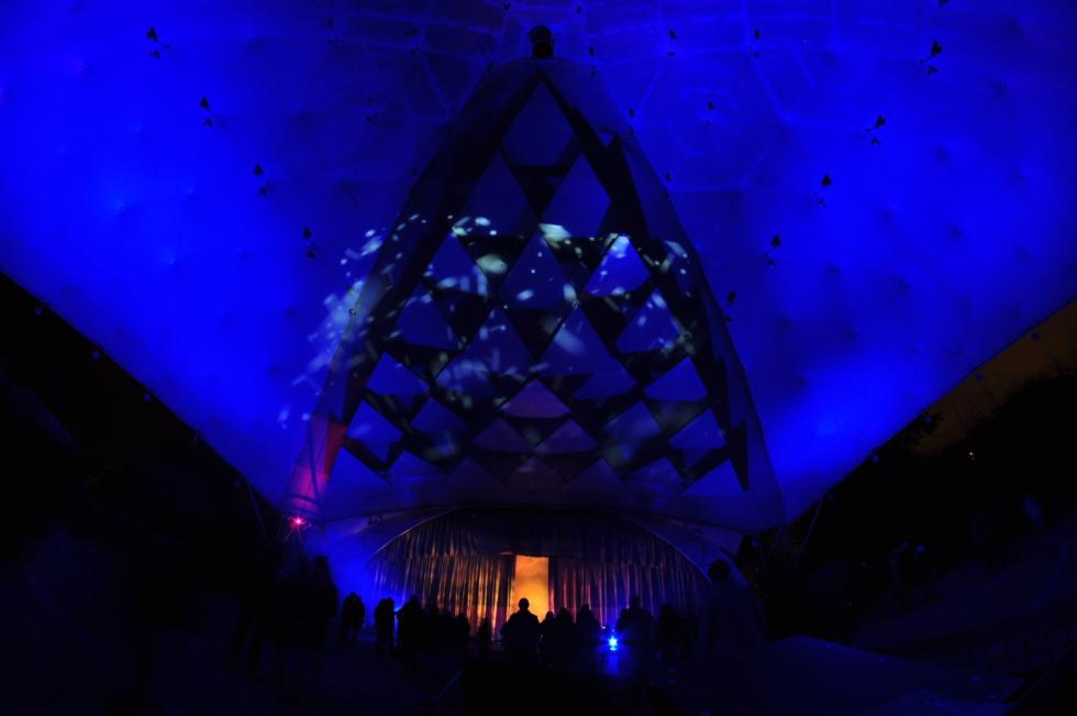 Illuminated stage at Gruga Park's music pavillion