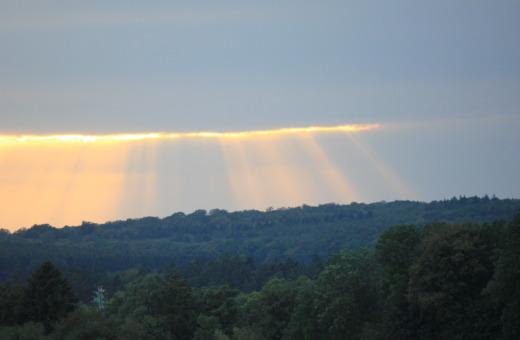 Orange sun breaks through the clouds
