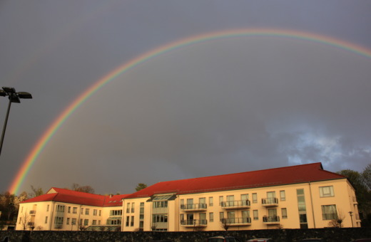 Rainbow over building