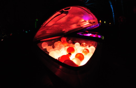 Red glowing lightbulbs in a garbage can
