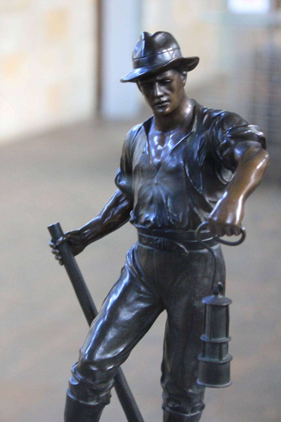 Sculpture of digger