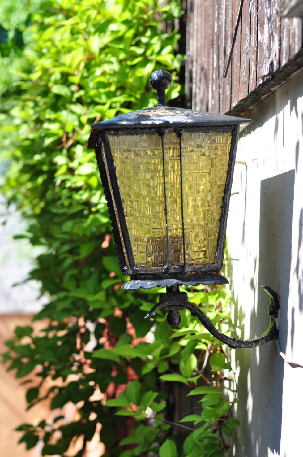 Old lantern with yellow glass
