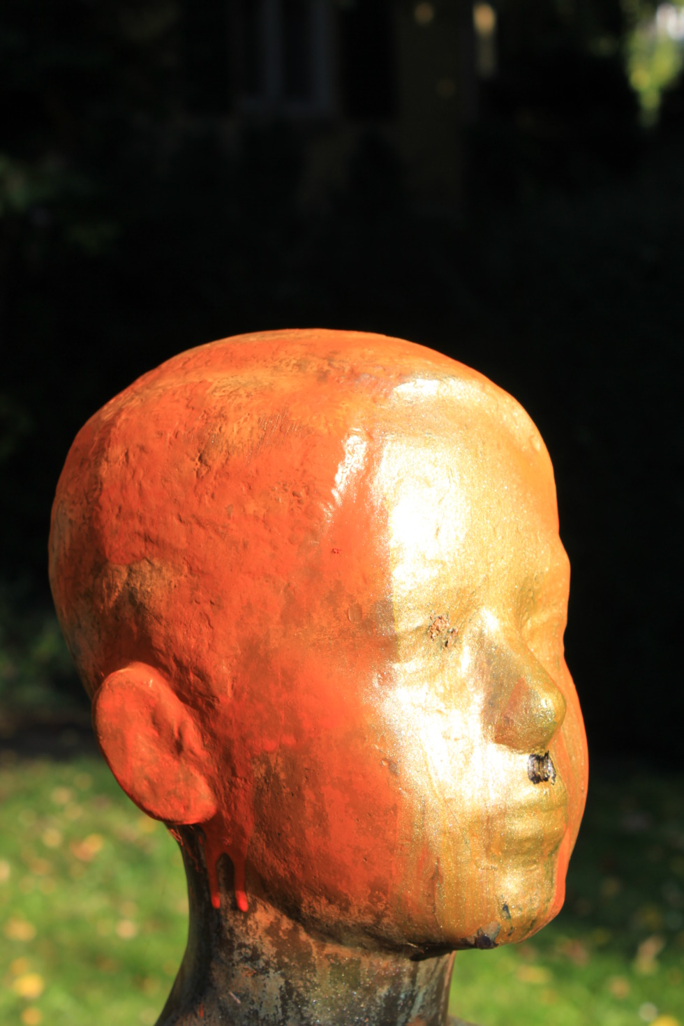 Sprayed and defaced bronze sculpture
