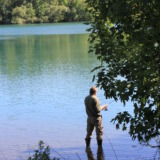 Angler with rubber boots in the river