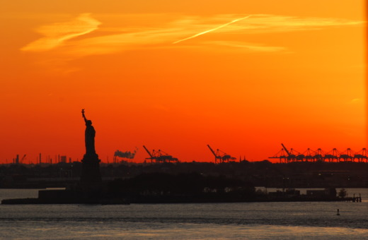 Silhouette of the Statue of Liberty in the sunset