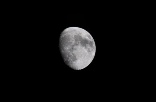 The moon in deep black night